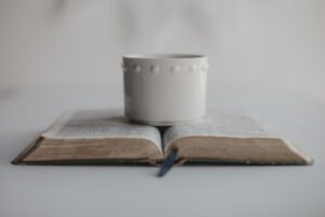 A Bible with a Cup